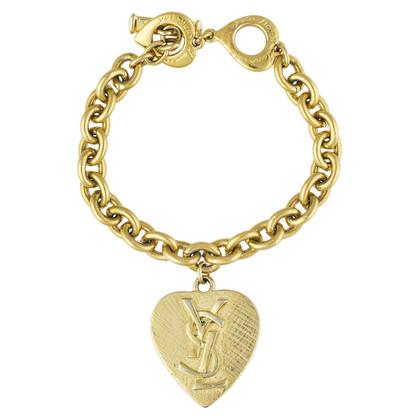 Yves Saint Laurent Gold colored bracelet with pendant