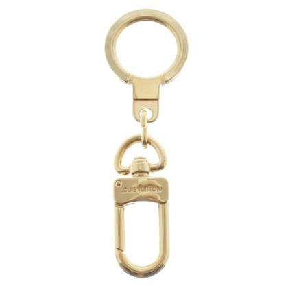 Louis Vuitton key case in gold