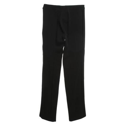 Gucci Zwarte broek met ritsen