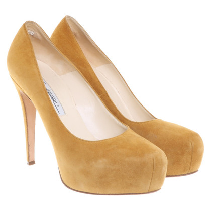 Brian Atwood pumps in mustard yellow