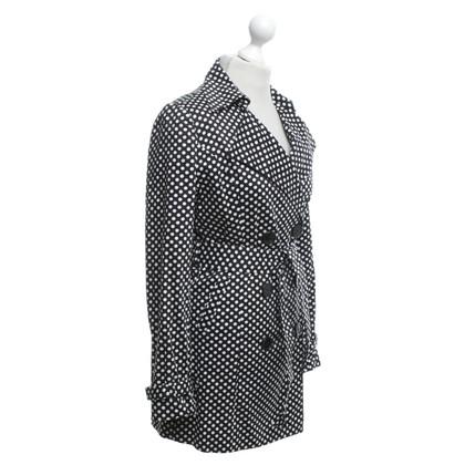 Vertigo Trench coat with polka dots