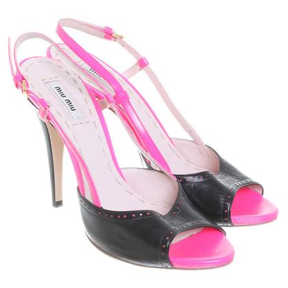 Miu Miu Sandals in pink/black