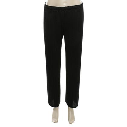 Issey Miyake pantaloni a pieghe in nero