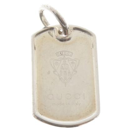 Gucci pendant with logo emblem