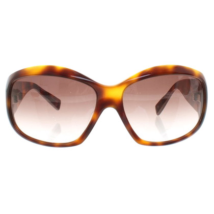 Oliver Peoples Sunglasses with shieldpatt pattern