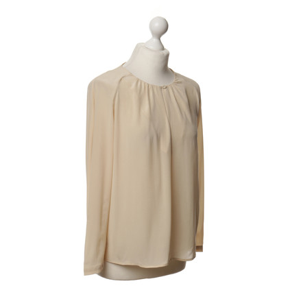 Closed Cream-coloured tunic