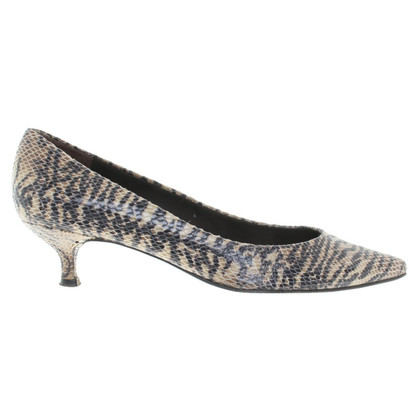 Stuart Weitzman pumps with reptile pattern