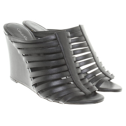 Calvin Klein Belted wedges in black