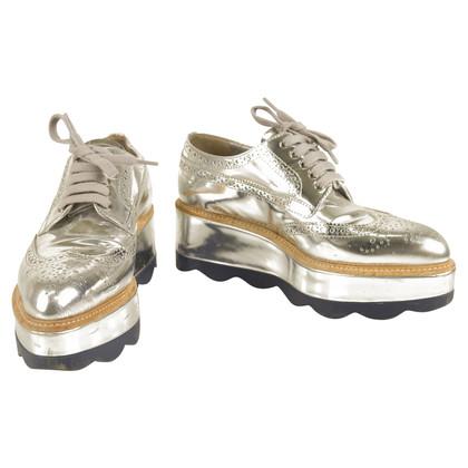 Prada Scarpe stringate in pelle metallizzata