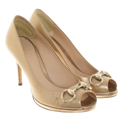 Gucci Peeptoes in gold colors