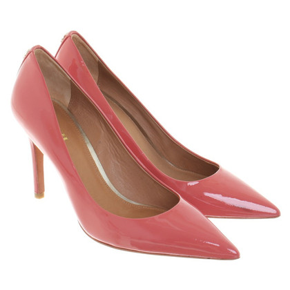 Coach coral red pumps