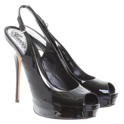 Gucci Slingback peeptoes made of patent leather