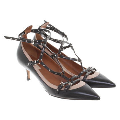 Valentino pumps with silver colored eyelets