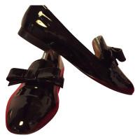 Prada Slippers in zwart-wit