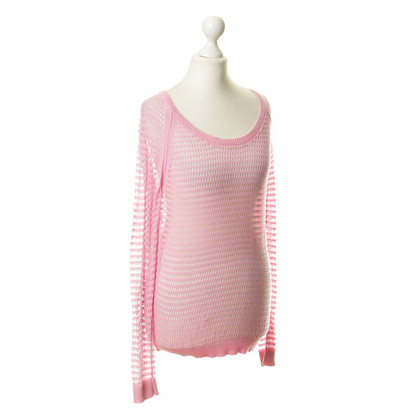 Dear Cashmere Hole knit sweaters in pink