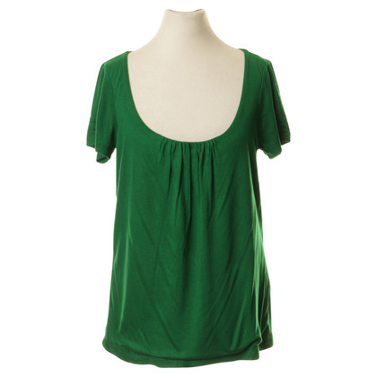 L.K. Bennett In green shirt with Ruffles