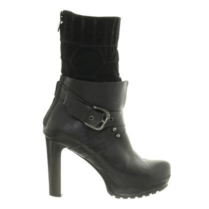 Konstantin Starke Ankle boots with straps and buckle