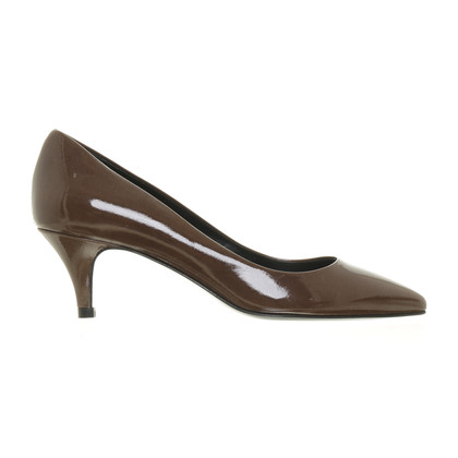 The Seller Brown patent leather pumps