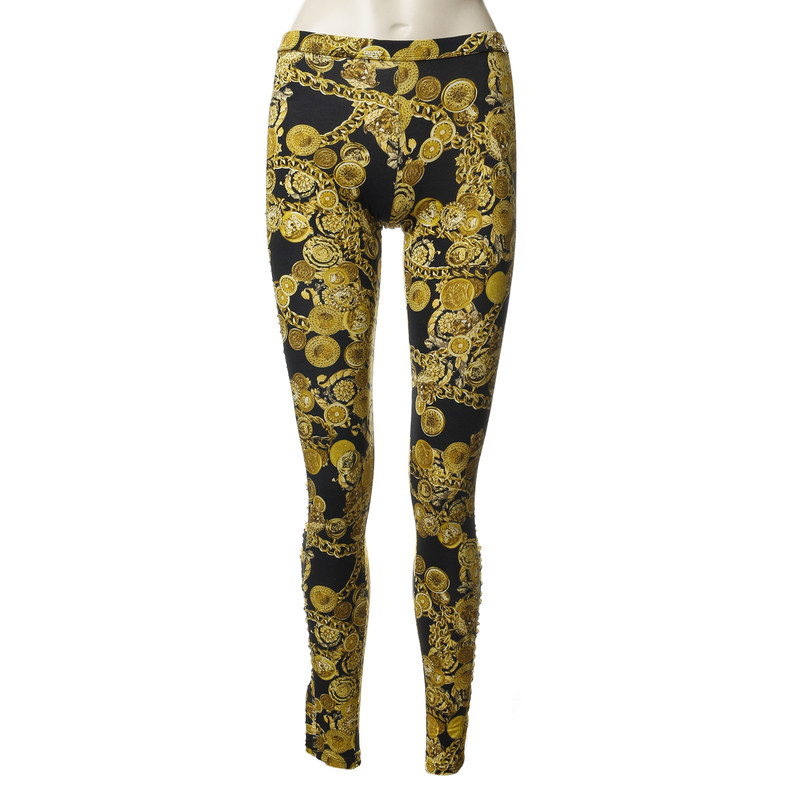 Versace Leggings with an opulent jewelry print in gold ...