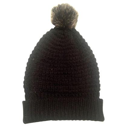 Schumacher Woolen hat with fur PomPoms