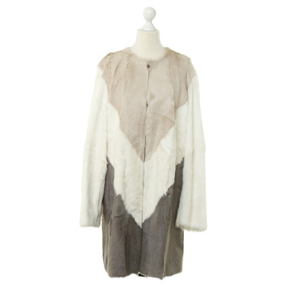 MSGM Sheepskin coat in Brown, white and grey