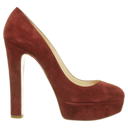 Christian Louboutin Peep toe pumps in red