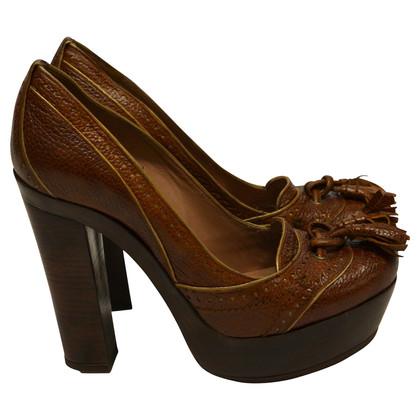 Pura Lopez pumps Brown