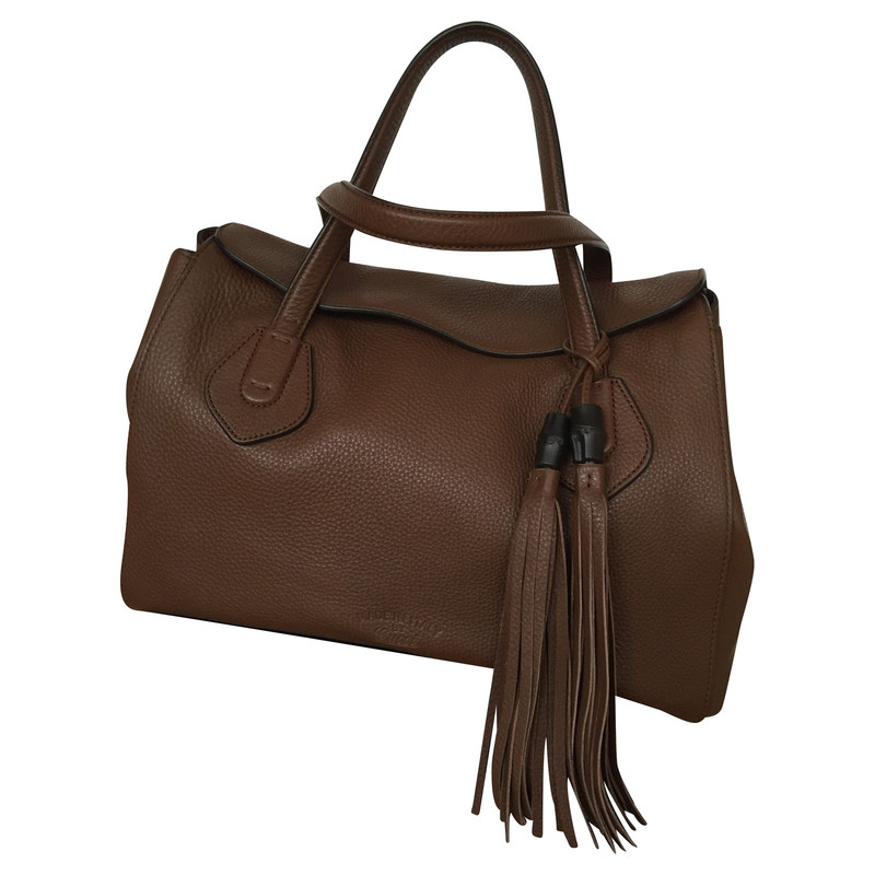 gucci sac avec des glands acheter gucci sac avec des glands second hand d 39 occasion pour 792 00. Black Bedroom Furniture Sets. Home Design Ideas