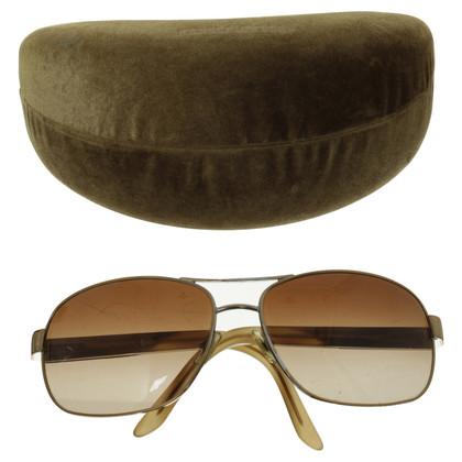 Miu Miu Sunglasses in gold
