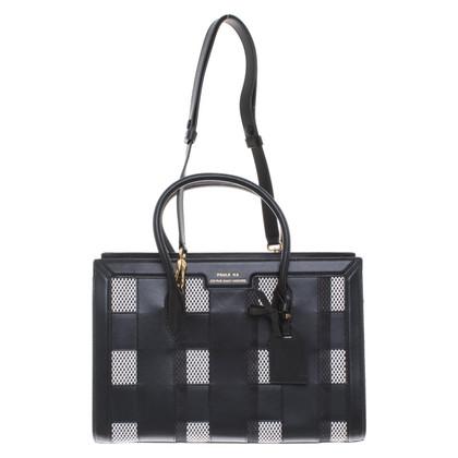 Paule Ka Handbag with checkerboard pattern