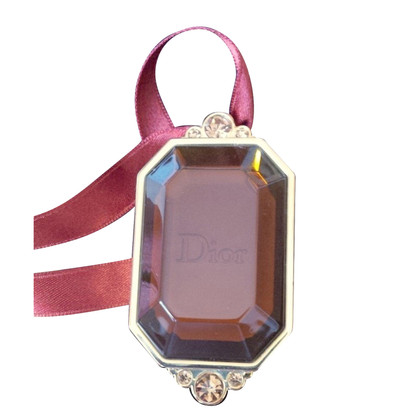 Christian Dior pendant with cream-highlighter