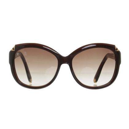 Louis Vuitton Zonnebrillen in bruin