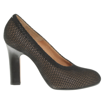 Maison Martin Margiela pumps with hole pattern