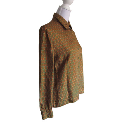 Hermès Silk blouse.