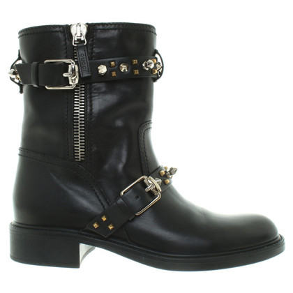 Gucci Leather boots with application