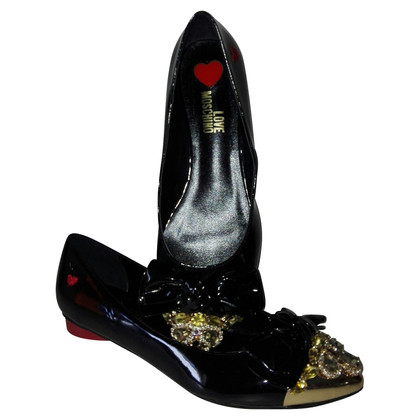 Moschino Love Patent leather slippers with gemstones