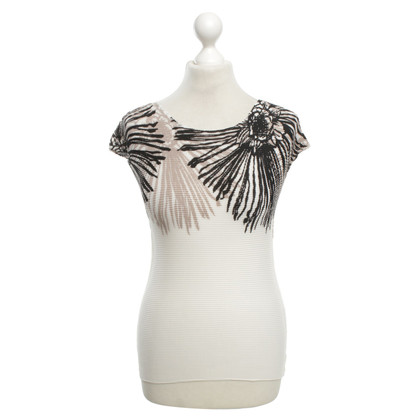 Issey Miyake Pleated top with floral print