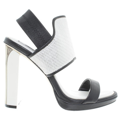 BCBG Max Azria Sandals in black and white