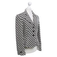 Armani Collezioni Blazer en laine avec un motif en zig-zag