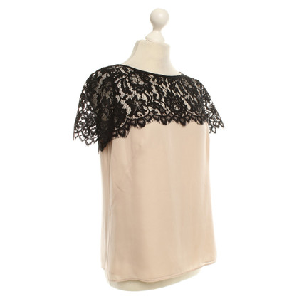 Milly Top con pizzo