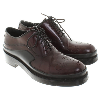 Prada Lace-up shoes with lace pattern