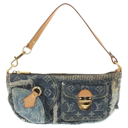 Louis Vuitton clutch made of denim