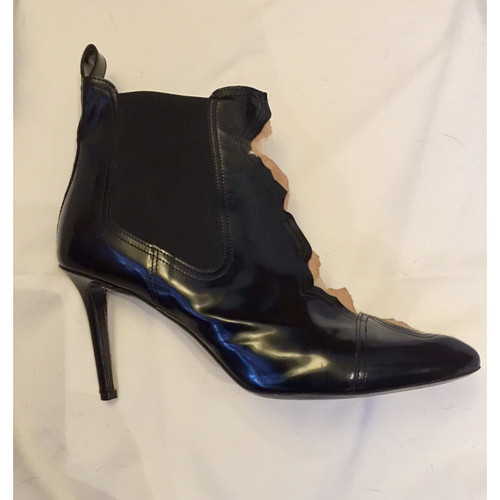 123c20e871b Maison Martin Margiela Ankle boots in Black - Second Hand Maison ...