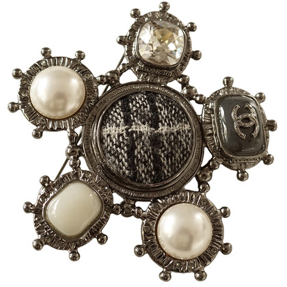 Chanel Brooch with beads and cabochons