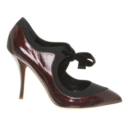Rupert Sanderson pumps in red