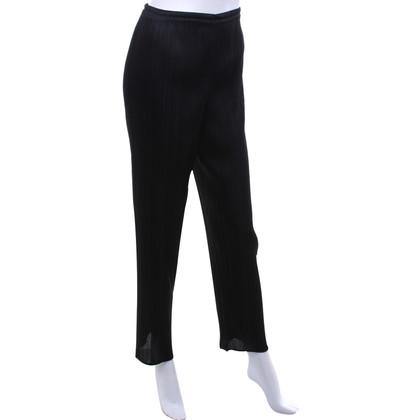 Pleats Please trousers in black