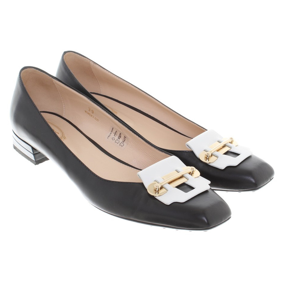 Tod's pumps in black / white