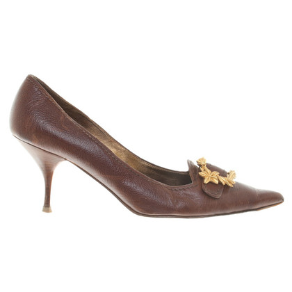 Prada pumps with gold buckle