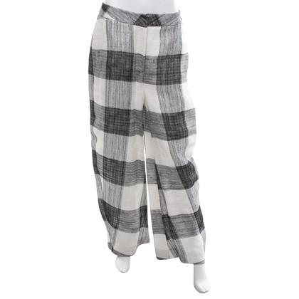 Acne Pantalon en noir / blanc