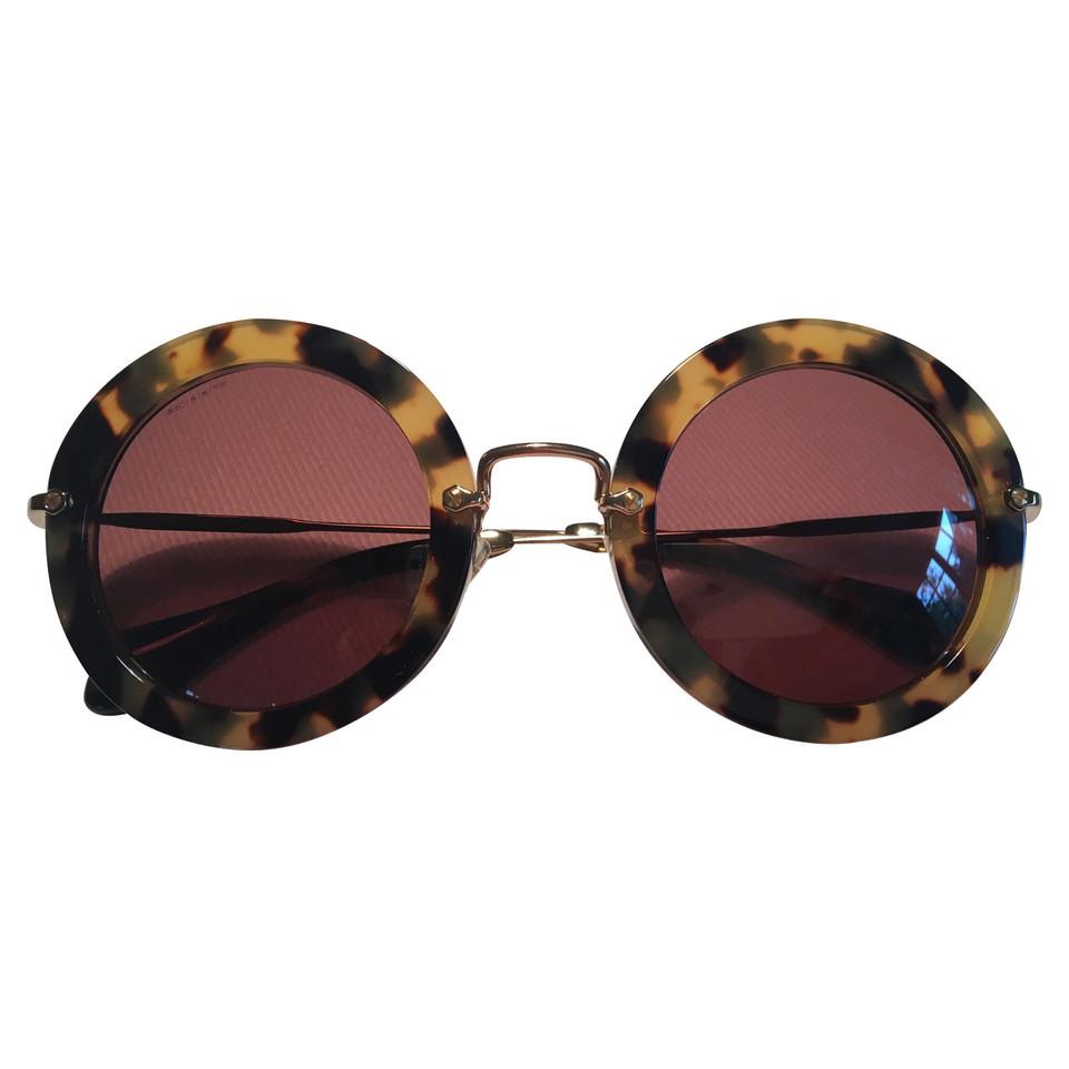 miu miu lunettes de soleil acheter miu miu lunettes de soleil second hand d 39 occasion pour 128. Black Bedroom Furniture Sets. Home Design Ideas